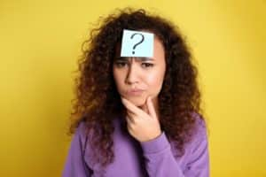 Women wonders why life cover and benefits with question mark post it not on her face